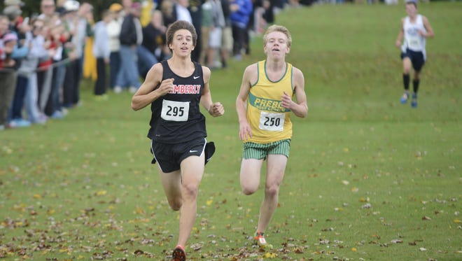 Green Bay Preble junior Nick Petersen (right) races to the finish line with Kimberly junior Isaac Benz during the WIAA Division 1 Manitowoc sectional at Meadow Links Golf Course on Saturday.