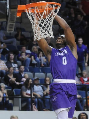 ACU's Jaylen Franklin slams the ball through the net, giving the Wildcats a 65-59 lead against Central Arkansas with 8:07 left in the game. The Bears rallied to beat ACU 74-72 in the Southland Conference game Saturday, Feb. 28, 2018 at Moody Coliseum.