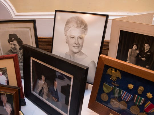 Photographs of Stephanie Rader and other items are displayed during a reception following her full-honors funeral.