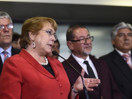 Chilean President Michelle Bachelet, left, speaks during