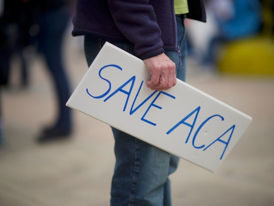 Protestors demonstrate during a health care rally at