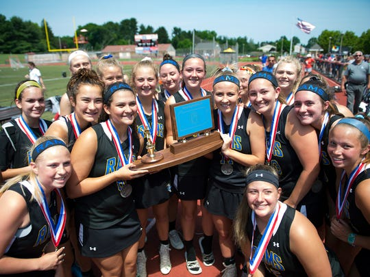Members of the Kennard Dale Girls Lacrosse team accept the PIAA Class 2A runner-up trophy at West Chester East High School on Saturday, June 10, 2017.