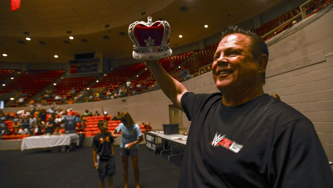 Jerry 'The King' Lawler shows his crown to the crowd during his 40th anniversary celebration on Thursday evening at Oman Arena.