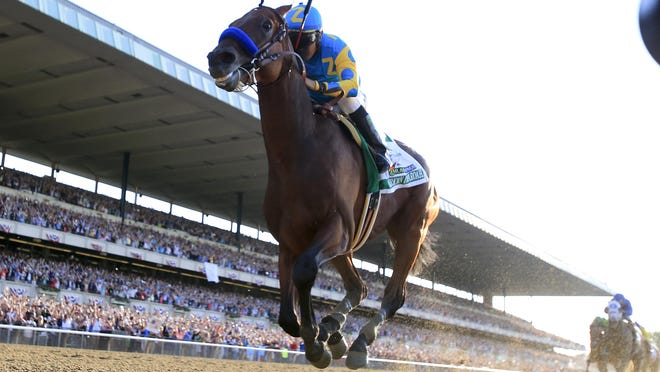 Victor Espinoza rides American Pharoah to victory at the Belmont Stakes and the Triple Crown. June 6, 2015