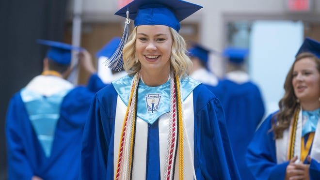 Tuscaloosa County senior Mackinley Atwood walks in a virtual graduation ceremony at Tuscaloosa County High School in Tuscaloosa, Ala. on Wednesday, May 20, 2020.
