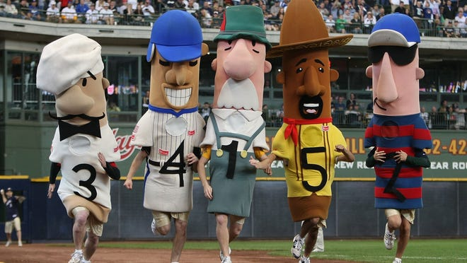 """MILWAUKEE - MAY 15: The """"Racing Sausages"""" compete in the 6th inning of a game between the Milwaukee Brewers and the Los Angeles Dodgers on May 15, 2008 at Miller Park in Milwaukee, Wisconsin. The Dodgers defeated the Brewers 7-2. (Photo by Jonathan Daniel/Getty Images)"""