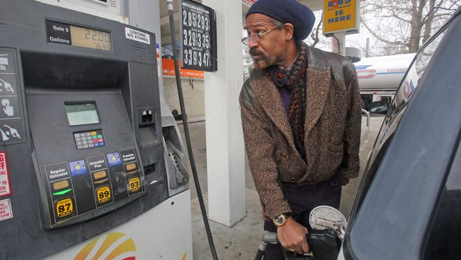 Gas prices have dipped. In December, Charles Schofield of New Rochelle fills up his car, at $2.85 a gallon for regular in New Rochelle.