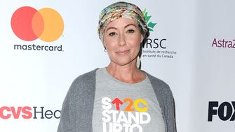 Shannen Doherty has traded her trademark brunette locks for a headscarf after shaving her head for chemotherapy.