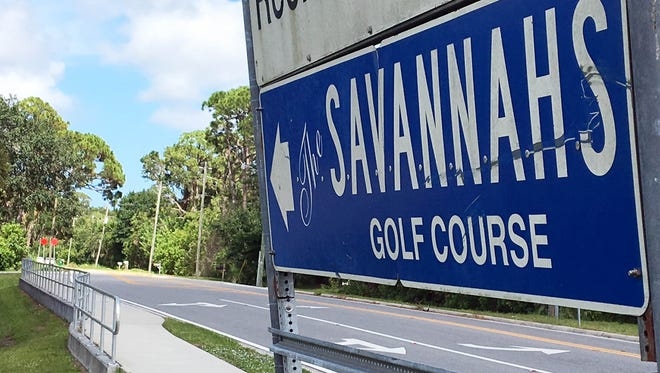 A sign points the way to The Savannahs golf course on Merritt Island.