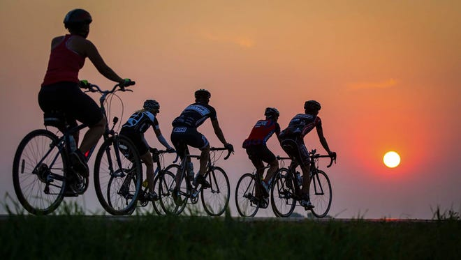 Riders head east to Hull during RAGBRAI 2014 from Rock Valley to Okoboji early Sunday July 20, 2014.