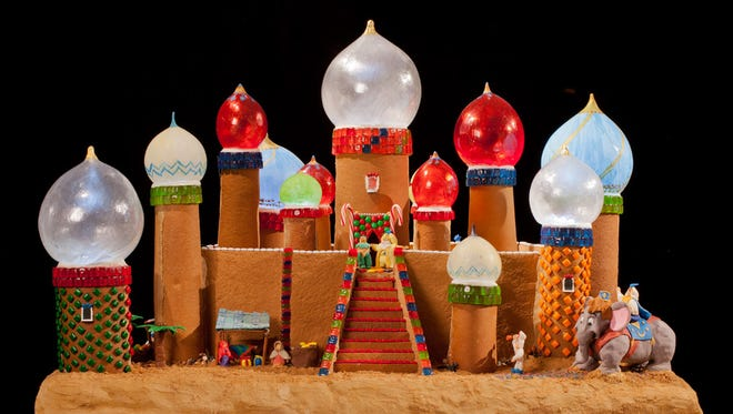 Visitors can vote by text for their favorite building at the 21st Annual Gingerbread Village at the Sheraton Seattle.