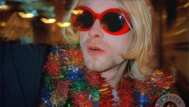This image of Kurt Cobain snapped by Alice Wheeler is just one example of what's available at Rock Paper Photo