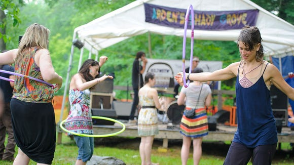 Music fans dance and play with hula hoops at the Shady Grove Music Fest in Arden in 2011.