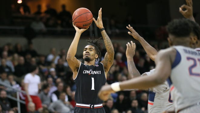 Cincinnati Bearcats guard Jacob Evans III (1) rises for a shot in the first half during NCAA basketball game between the Connecticut Huskies and Cincinnati Bearcats, Thursday, Feb. 22, 2018, at BB&T Arena in Highland Heights, Ky.