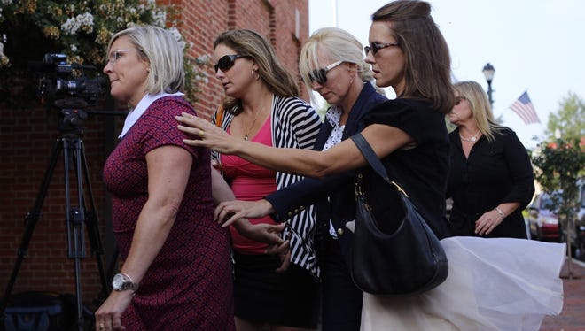 Molly Shattuck walks into the Sussex County Courthouse surrounded by supporters for sentencing on Friday morning.