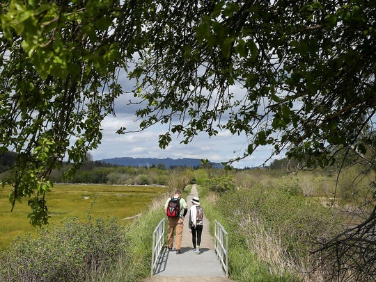 Hikers on the River Estuary Trail at the Theler Wetlands in Belfair. (KITSAP SUN FILE)