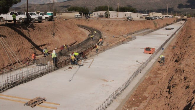 A construction crew works on the seventh phase of the McKinley channel, directly west of Florida Avenue, south of First Street,