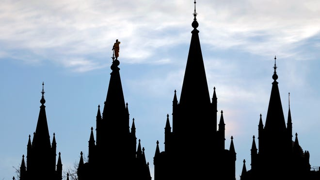 The angel Moroni statue, silhouetted against the sky, sits atop the Salt Lake Temple at Temple Square, Jan. 3, 2018, in Salt Lake City.