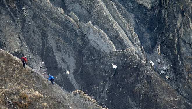 Search and rescue workers at the crash site of the Germanwings Airbus A320 in the French Alps.