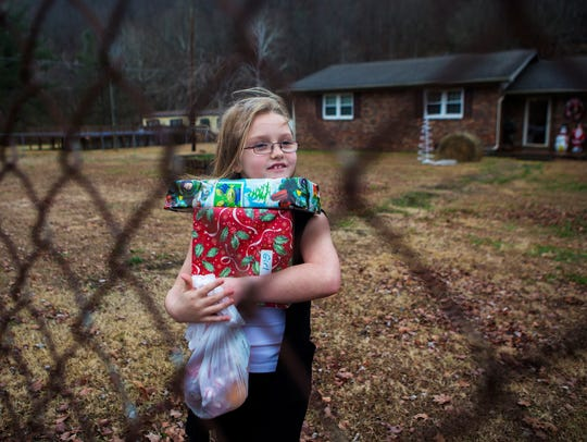 Madi Lemar, 7, was all smiles as she held her Christmas