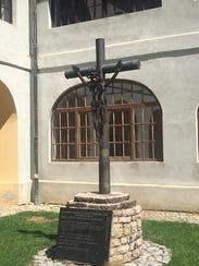 This memorial crucifix is on the grounds of a church