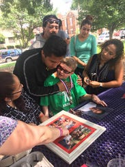 Peyton West, 13, of Goshen, Ohio, meets with 12-year-old