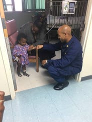 While visiting the Virgin Islands after the hurricanes, Surgeon General Jerome Adams gets a fist bump from a child who, like Adams, has asthma.