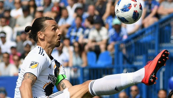 Los Angeles Galaxy forward Zlatan Ibrahimovic plays the ball during the first half of the game against the Montreal Impact at Stade Saputo in Montreal.