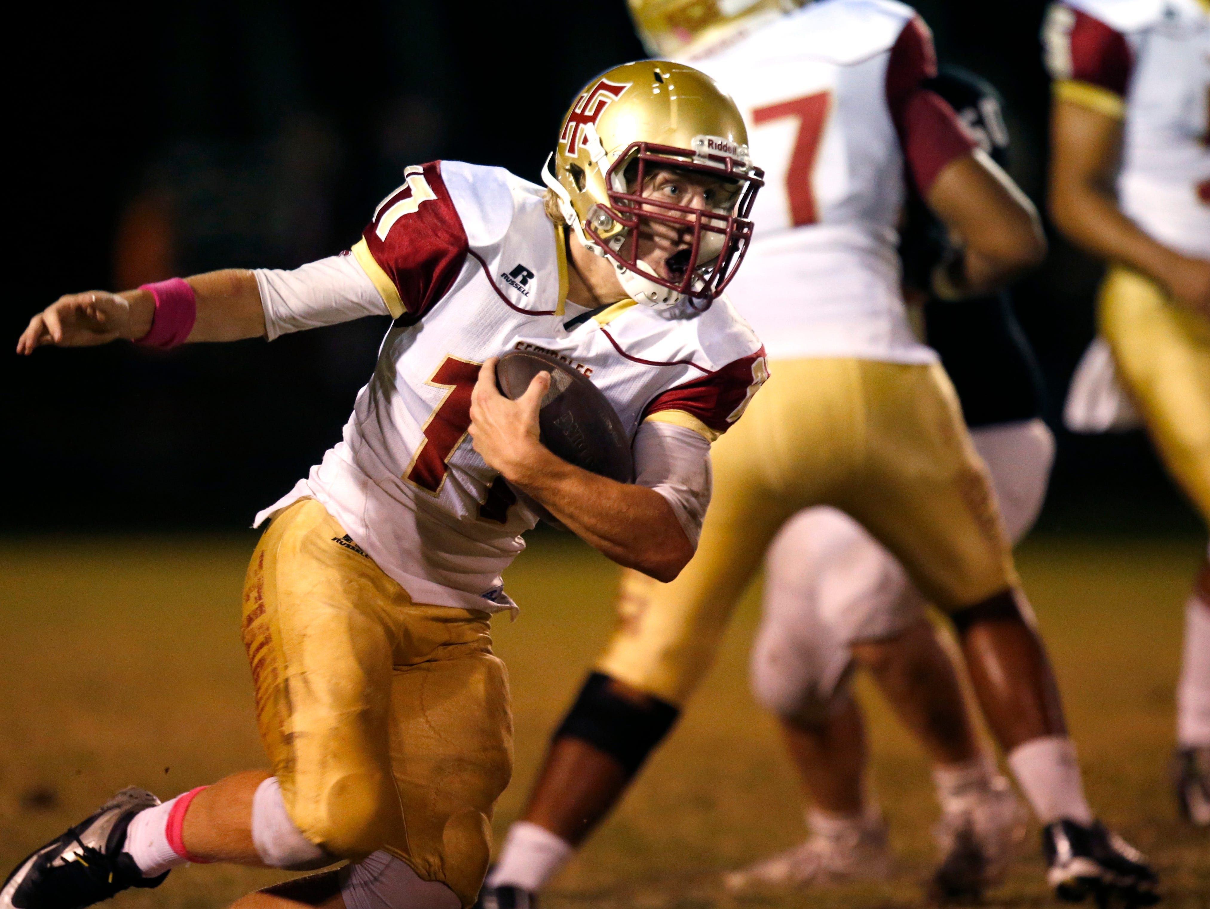 Florida High's Mike Greaves runs the ball against NFC on Friday.