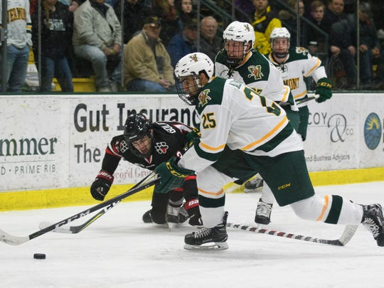 Vermont forward Matt Alvaro (25) plays the puck during the men's hockey game between the Northeastern Huskies and the Vermont Catamounts at Gutterson Fieldhouse on Friday night February 16, 2018 in Burlington.
