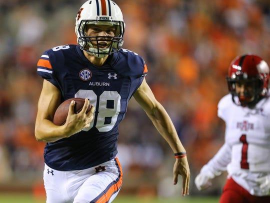 Auburn kicker Daniel Carlson (38) carries the ball