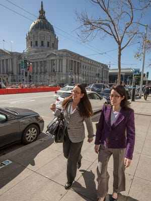 Ellen Pao, right, a former venture capital partner at Kleiner Perkins Caufield and Byers, leaves the San Francisco Civic Center Courthouse with her attorney Therese Lawless on Feb. 24.