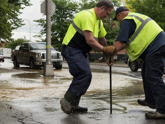 Emergency turners shut the water off after a water main break at the 1000 block of West Jefferson Street on Wednesday, June 20, 2018.