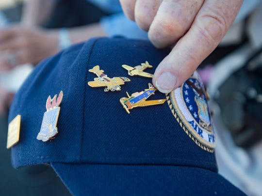 Veteran Dave Cunningham shows off pins on his hat during the Collings Foundation's Wings of Freedom Tour at Northern Colorado Regional Airport Saturday, July 14, 2018. Cunningham, 98, was a flight instructor with the United States Air Force during World War II, training pilots on aircraft like the B-26 and A-26, among others.