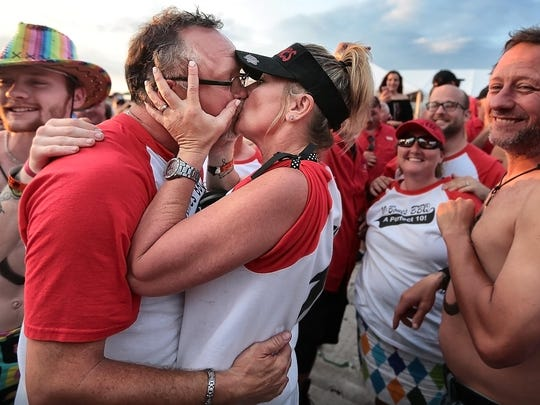 Mark West, pitmaster of 10Bones BBQ, celebrates with his wife Misty West after they found out they had won a first place in ribs for the second year in a row on the final day of the annual Memphis in May World Championship Barbecue Cooking Contest at Tom Lee Park.