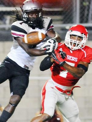 Florida Tech wide receiver Xavier Milton, left, and West Alabama's Malcolm Butler battle for the ball during a 2013 game held at the Palm Bay High Stadium.