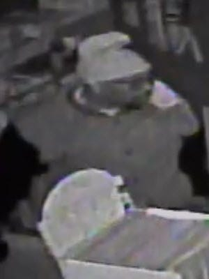 One of the 3 suspects captured on surveillance video