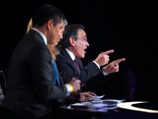 CNBC on-air editor Rick Santelli asks a question during