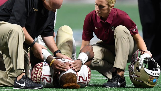 Florida State quarterback Deondre Francois (12) lies injured on the field against Alabama in the Chick-fil-a Classic at the Mercedes - Benz Stadium in Atlanta, Ga., on Saturday September 2, 2017.