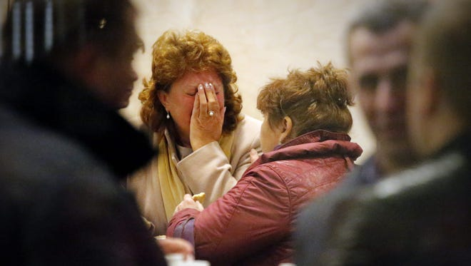 Relatives of passengers of MetroJet Airbus A321 weep at Crown Plaza Hotel in St. Petersburg, Russia. The plane crashed in Egypt's Sinai peninsula early Saturday, killing all 224 people aboard.