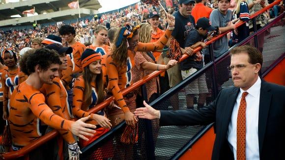 Auburn head coach Gus Malzahn high fives fans before