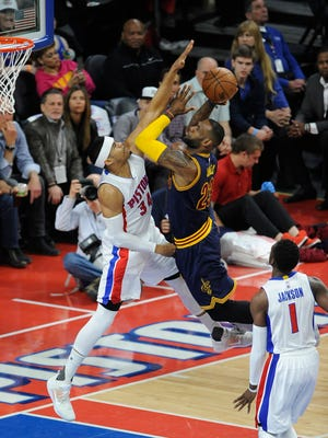 Pistons Tobias Harris goes up against Cav's LeBron James in the first quarter.