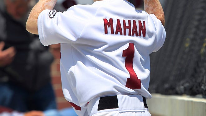 Six-year-old Owen Mahan, Pittsboro, who suffered burns over 98 percent of his body when he was two years old and living in Lawrence, Kansas, is part of the University of Indianapolis baseball team. He has his own Greyhounds jersey bearing his name and the number 1, which he wore during the Greyhounds' game against the University of Southern Indiana at Westfield's Grand Park on Saturday, May 3, 2014.