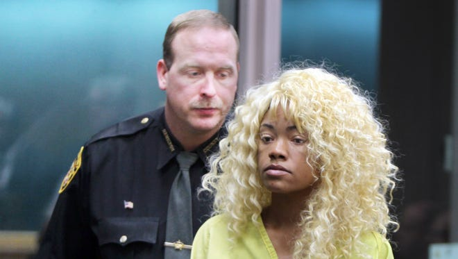 Shevelle Richards leaves court after being arraigned on a charge of aggravated homicide in the death of her father, Johnny Richards.  She was ordered held on $500,000 bond.