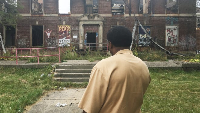 """Tommy """"The Hitman"""" Hearns, who got his start at the Kronk Gym, came to see its charred ruins after a fire in Detroit on Sunday, October 8, 2017."""