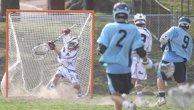 Suffern's Steven Vaccarri, (9) scores past Nyack goalie Will Ramos during their lacrosse game at Nyack May 7, 2013. Nyack won 14-7. ( Peter Carr / The Journal News )