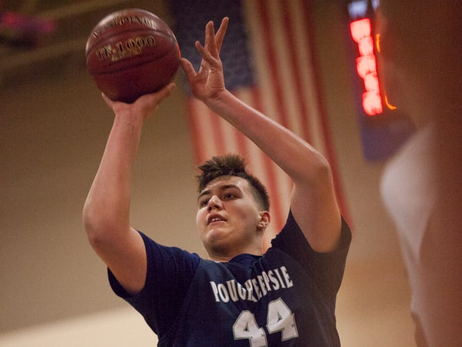 Corey Simmons takes a free throw shot against Goshen in Poughkeepsie's 100-92 winning game, securing the Section 9 Class A basketball championship title at Mount Saint Mary College in Newburgh, March 5, 2017