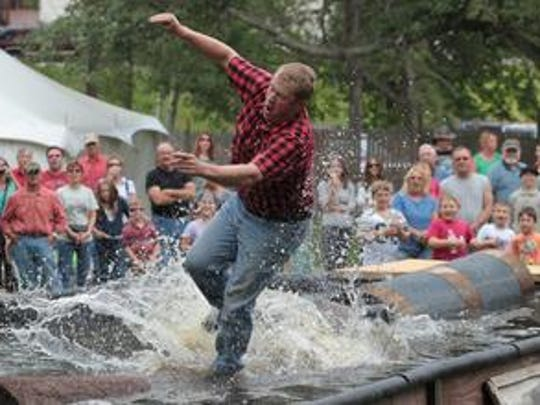 Lumberjack Charlie Goodmundson heads for the water while trying to run across several loags as part of the All American Lumberjack Show as Mosinee celebrated pioneers of north-central Wisconsin with its annual summer festival Little Bull Falls LogJam in 2013.