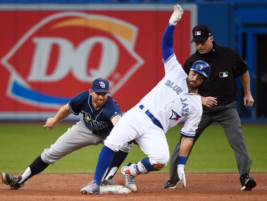Toronto Blue Jays center fielder Kevin Pillar (11) slides into second base on a double ahead of the tag by Tampa Bay Rays second baseman Brad Miller (13) during the second inning of a baseball game, Wednesday, Aug. 16, 2017 in Toronto. (Nathan Denette/The Canadian Press via AP)
