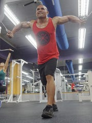 Bodybuilding competitor Mike Duay trains for the 2015 Michelob Ultra Guam National Fitness Championships and International Invitational by working out at Paradise Fitness in Dededo on Saturday, Sept. 12.